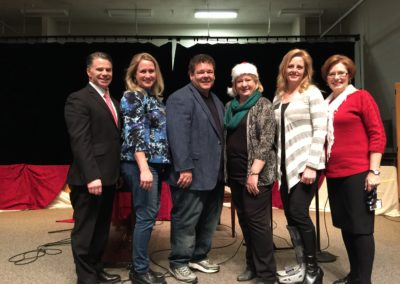 Christmas charity event at WJ Middle with Steve and Lisa James, Barbara Smith, Mayor Ramsey, Principal Kathy Ridding