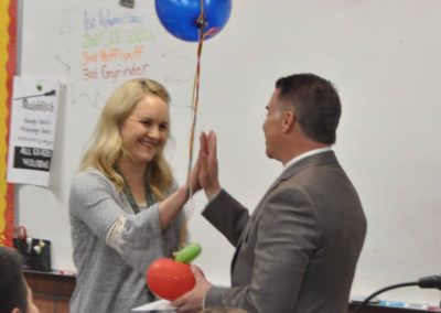 Giving out Teacher of the Year Awards in the classroom