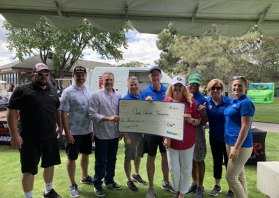 JEF Board at Golf Tourney getting a check from Walmart